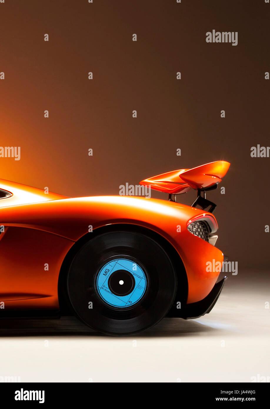 McLaren P1 Supercar with 45 vinyl record rear wheel. - Stock Image