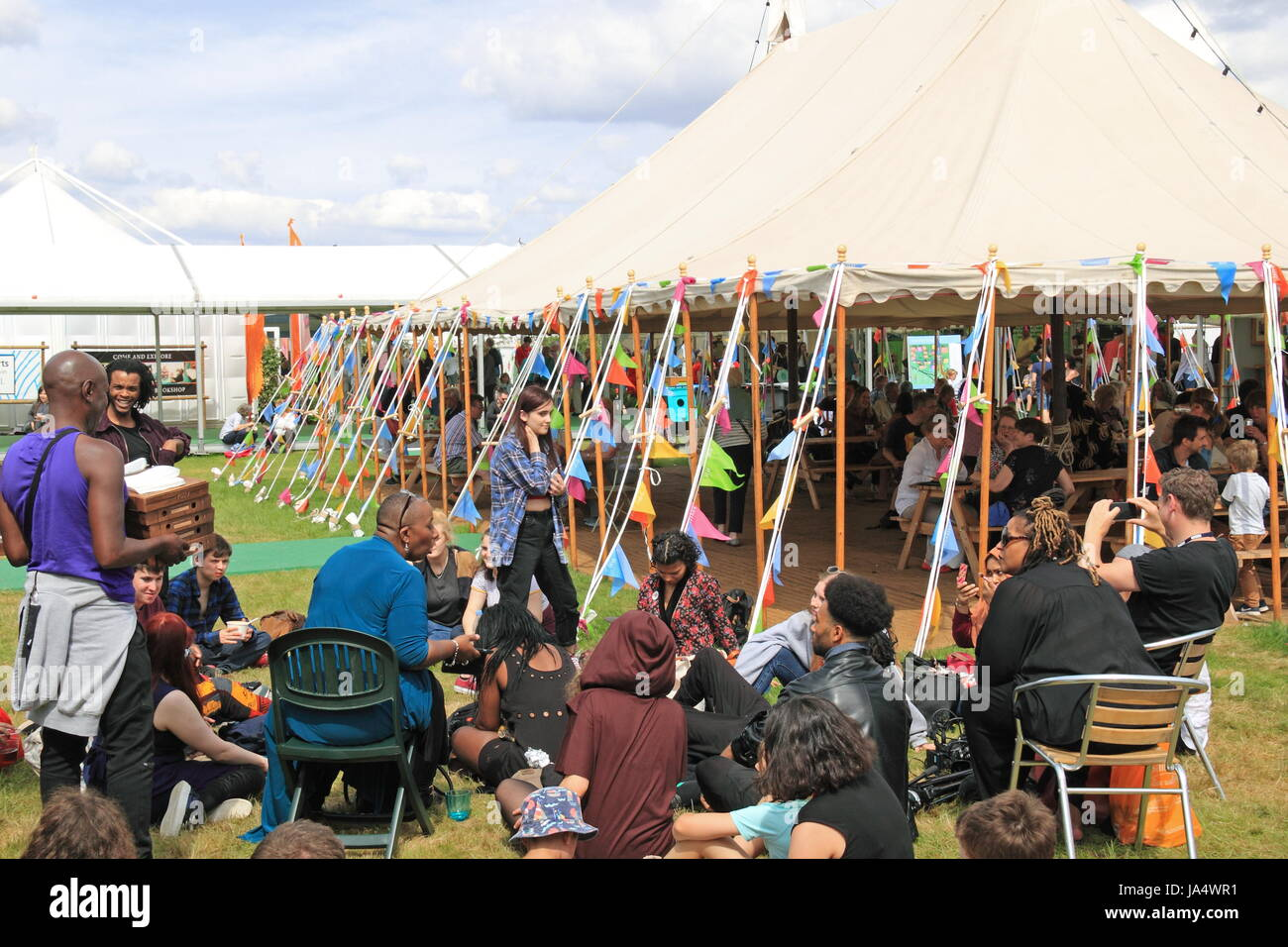 Festival-goers relaxing in the sun, Hay Festival 2017, Hay-on-Wye, Brecknockshire, Powys, Wales, Great Britain, - Stock Image