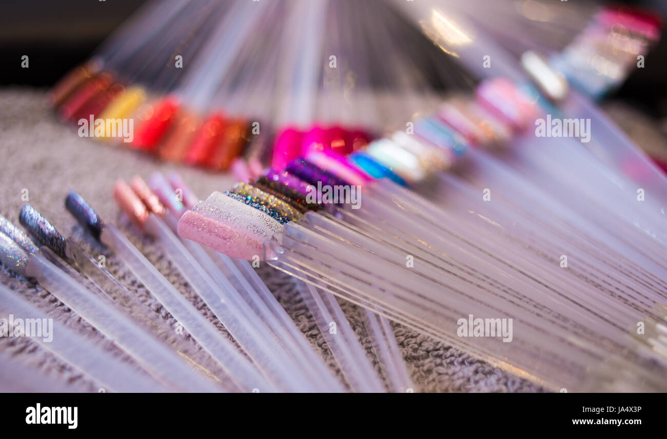 Colourful selection of nail polish colour options on display in a ...