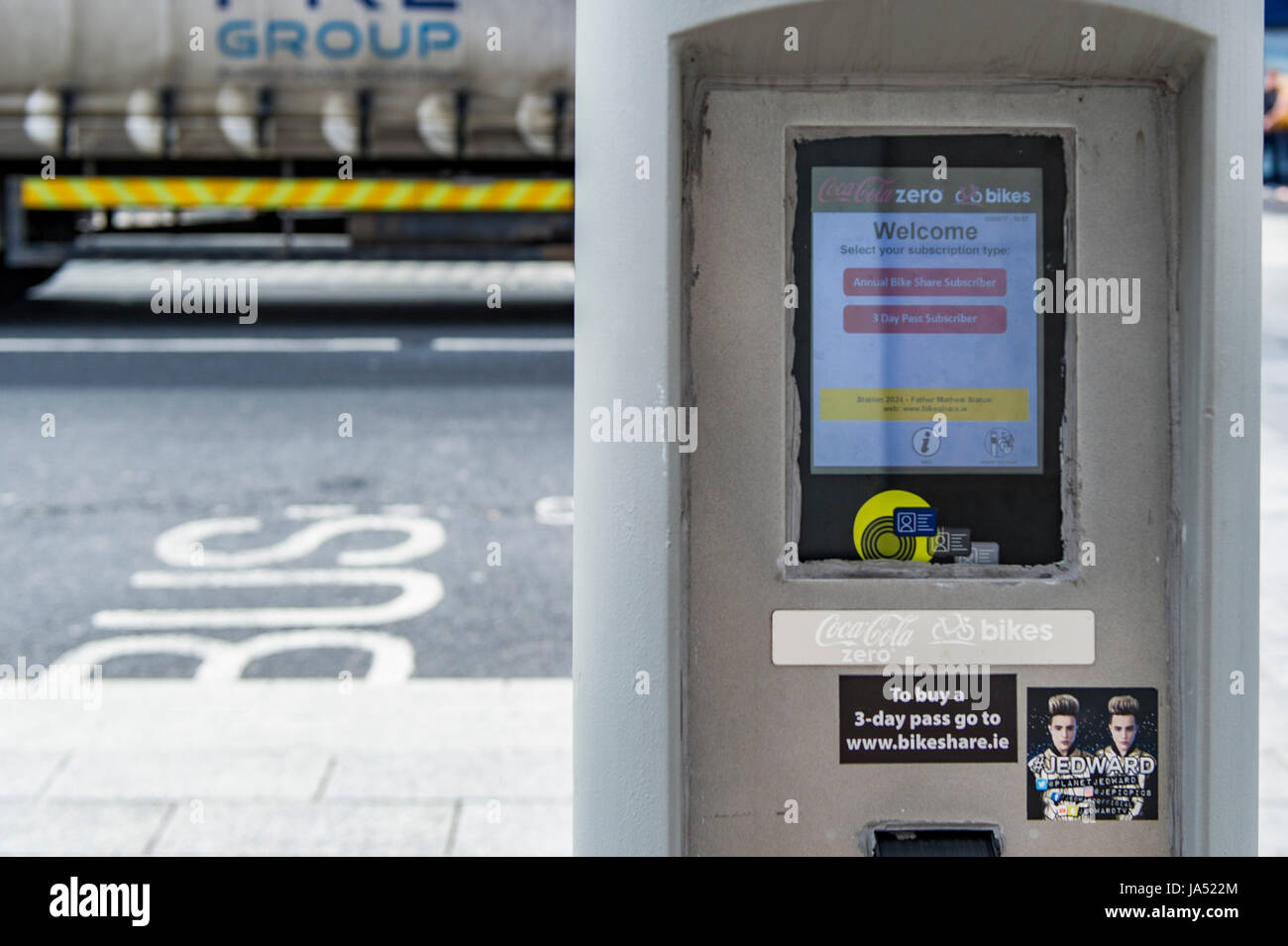 Coca Cola sponsored Bikeshare payment console in Cork, Ireland. - Stock Image