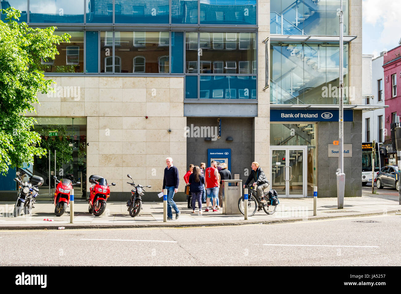 People queuing at a Bank of Ireland ATM on South Mall, Cork, Ireland. - Stock Image