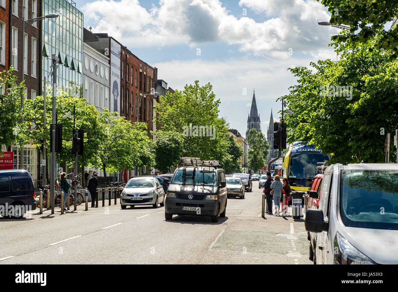 South Mall Street, Cork, Ireland with vehicles, cars, pedestrians, copy space, offices on a sunny Friday. - Stock Image