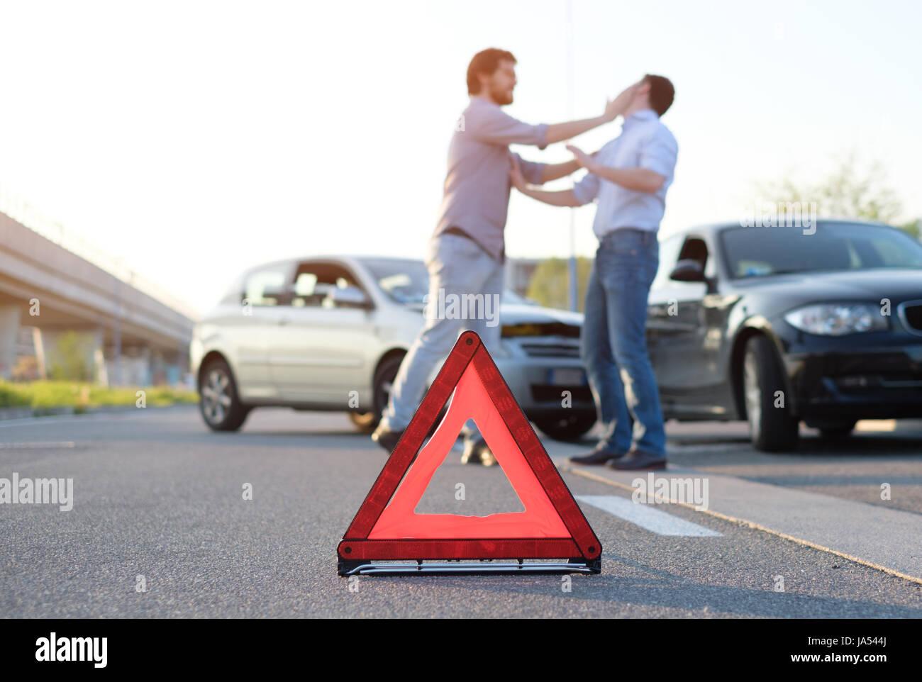 Two angry men arguing after a car fender-bender crash - Stock Image