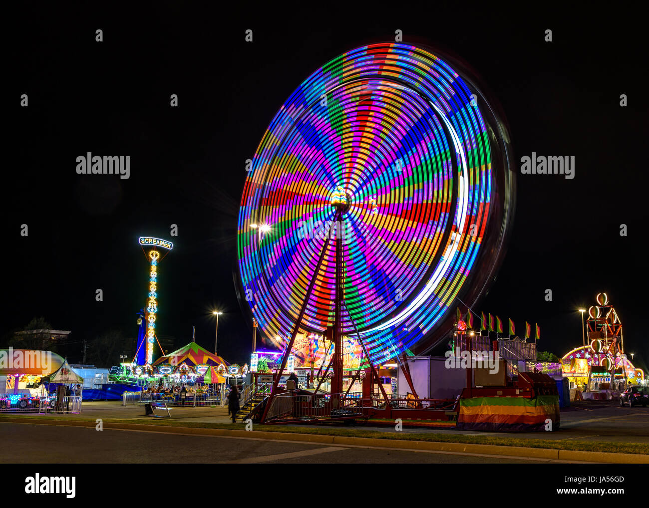 What goes up, must come down; spinning wheel gotta go round. Stock Photo