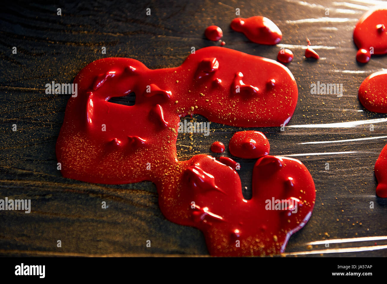 Drops frozen mirror glaze for decorating cakes and pastries. food film - Stock Image
