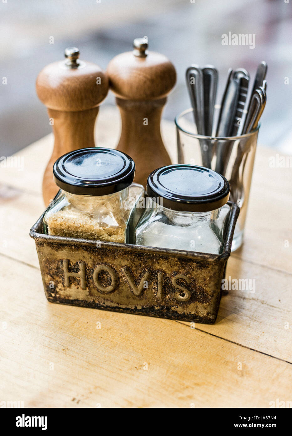 Condiments arranged using a old loaf tin - Stock Image