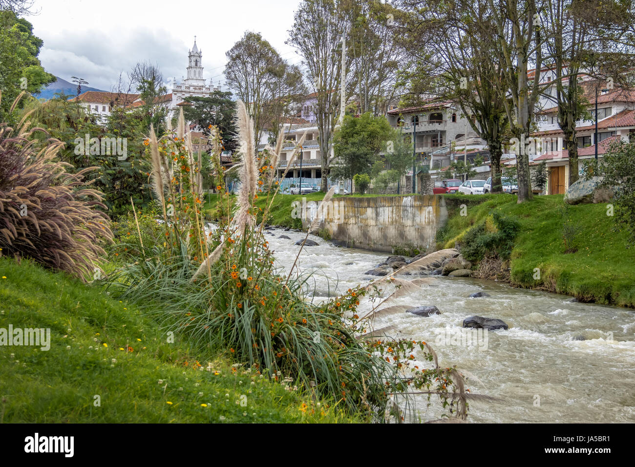 Tomebamba river and Todos los Santos Church tower - Cuenca, Ecuador - Stock Image