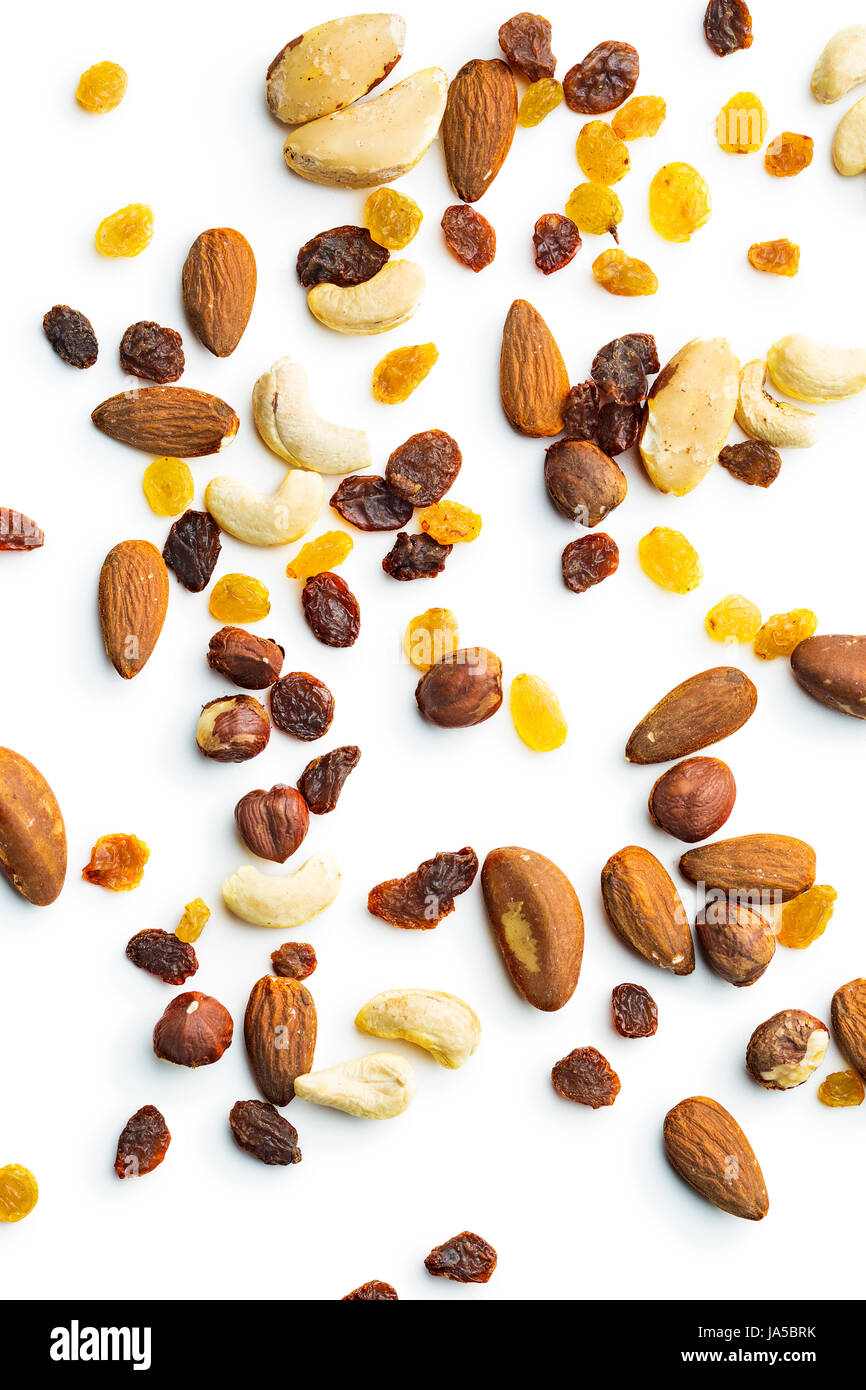 Various nuts and raisins isolated on white background. - Stock Image