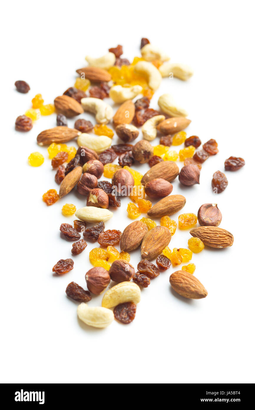 Various nuts and raisins isolated on white background. Stock Photo
