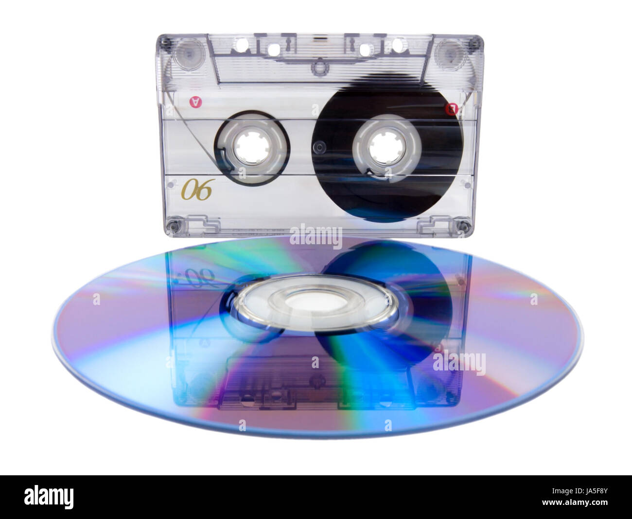Analog audio tape cassette and digital compact disc isolated on a white background - Stock Image