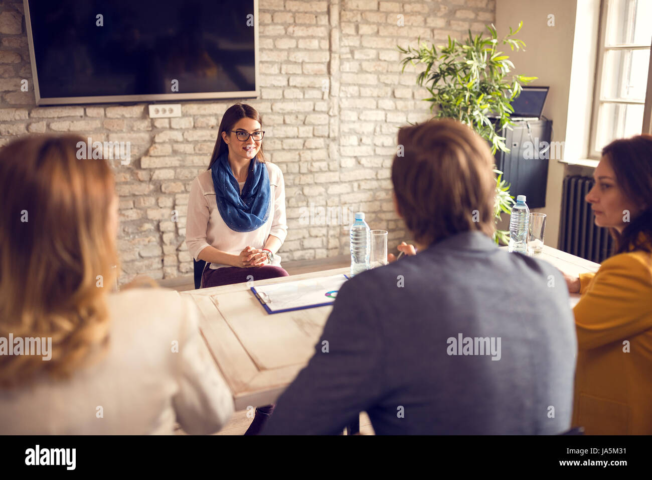 Young female on job interview with commission - Stock Image