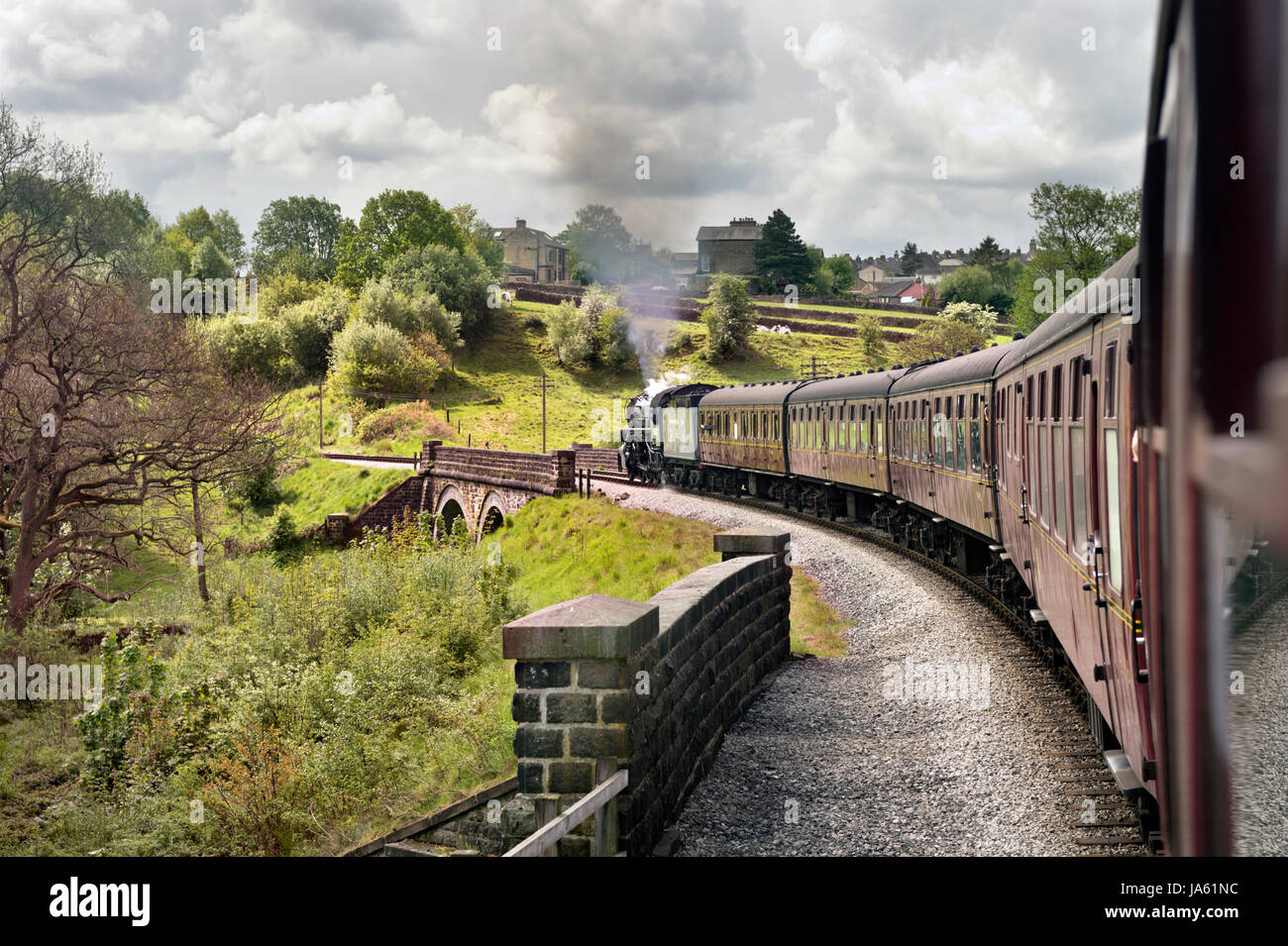 Haworth 1940s Weekend. Train hauled by American World War 2 S160 2-8-0 loco No. 5820, Keighley and Worth Valley - Stock Image