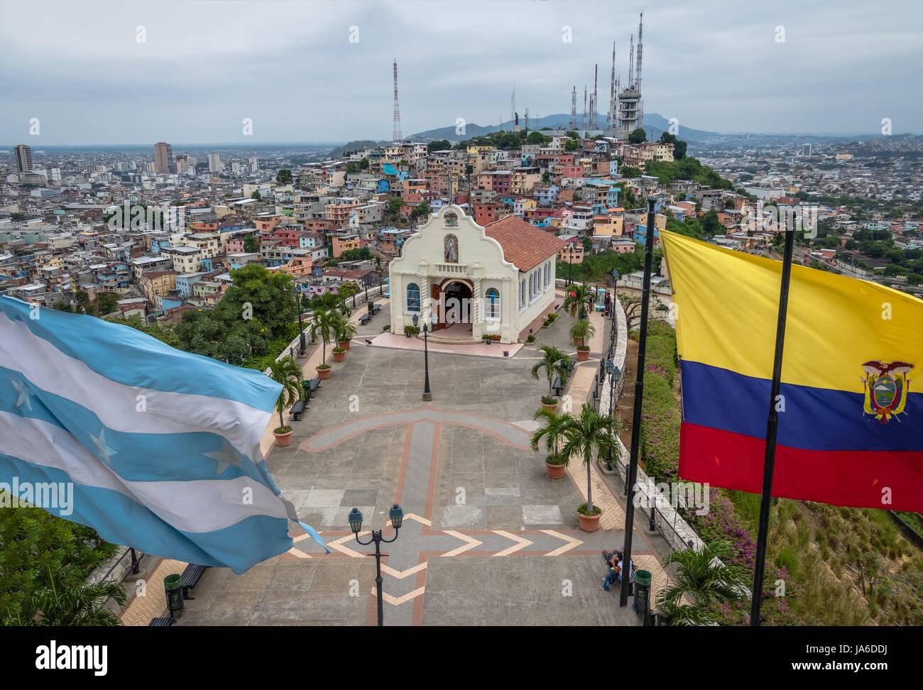 Santa Ana Church on top of Santa Ana hill with Ecuador and city flags - Guayaquil, Ecuador - Stock Image