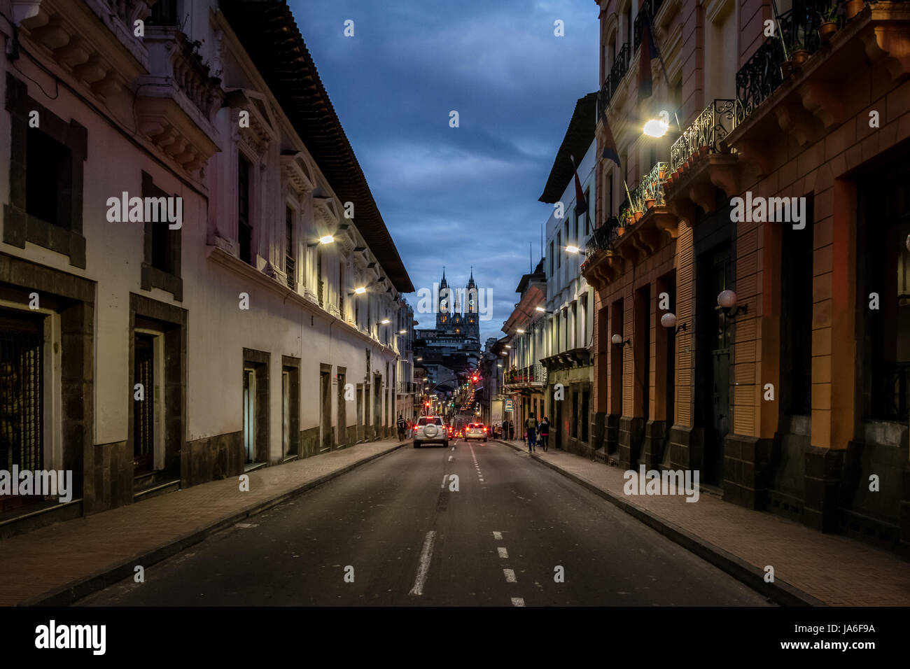 Street of Quito and Basilica del Voto Nacional at night - Quito, Ecuador - Stock Image
