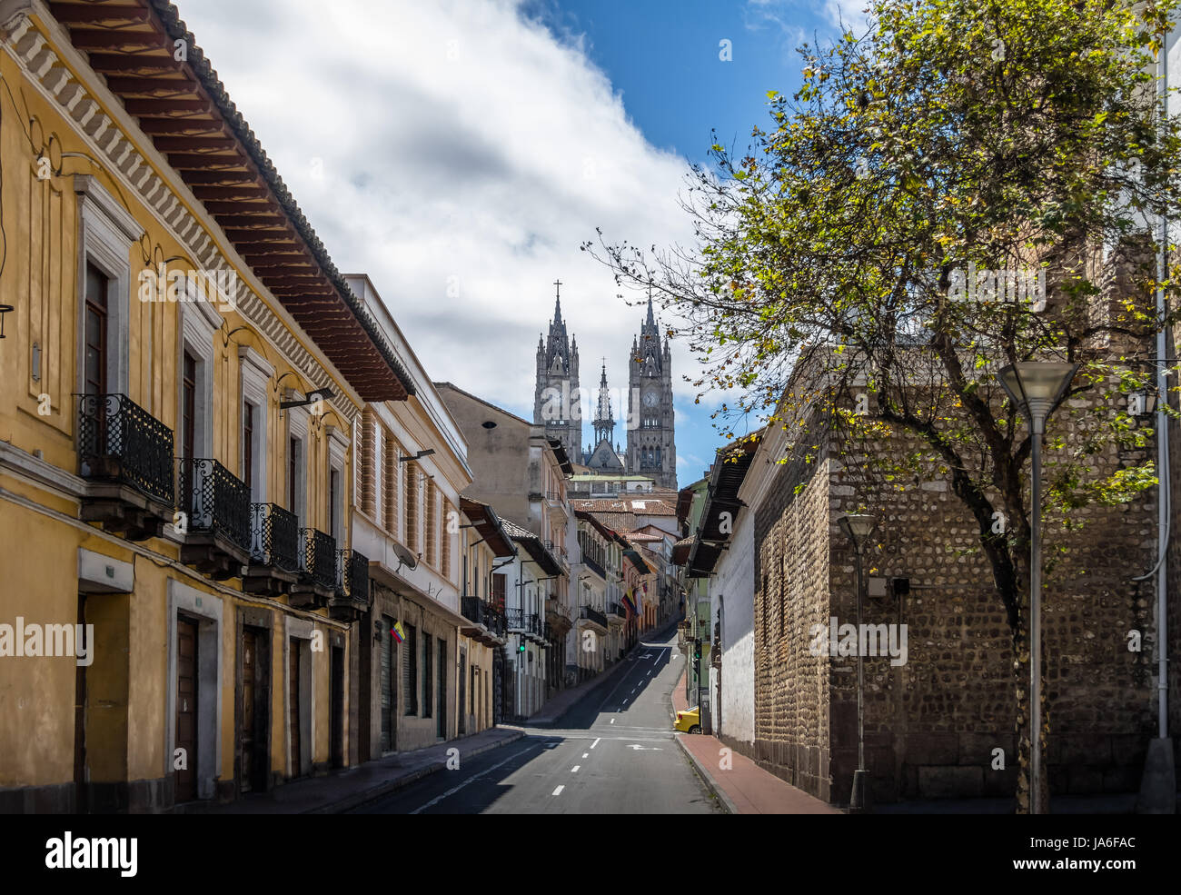 Street of Quito and Basilica del Voto Nacional - Quito, Ecuador - Stock Image