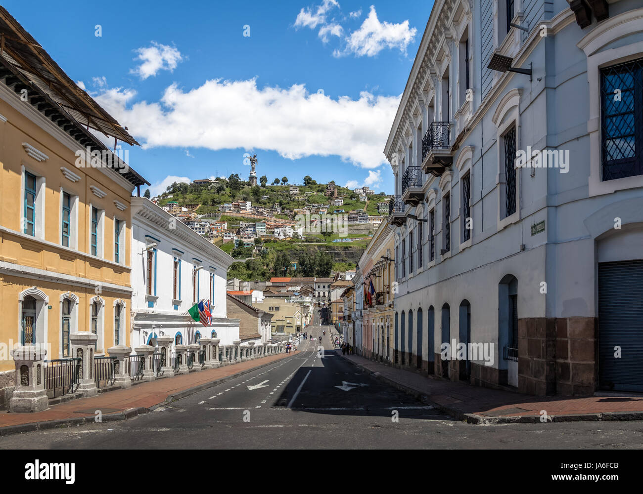 Street of Quito and Monument to the Virgin Mary on the top of El Panecillo Hill - Quito, Ecuador - Stock Image