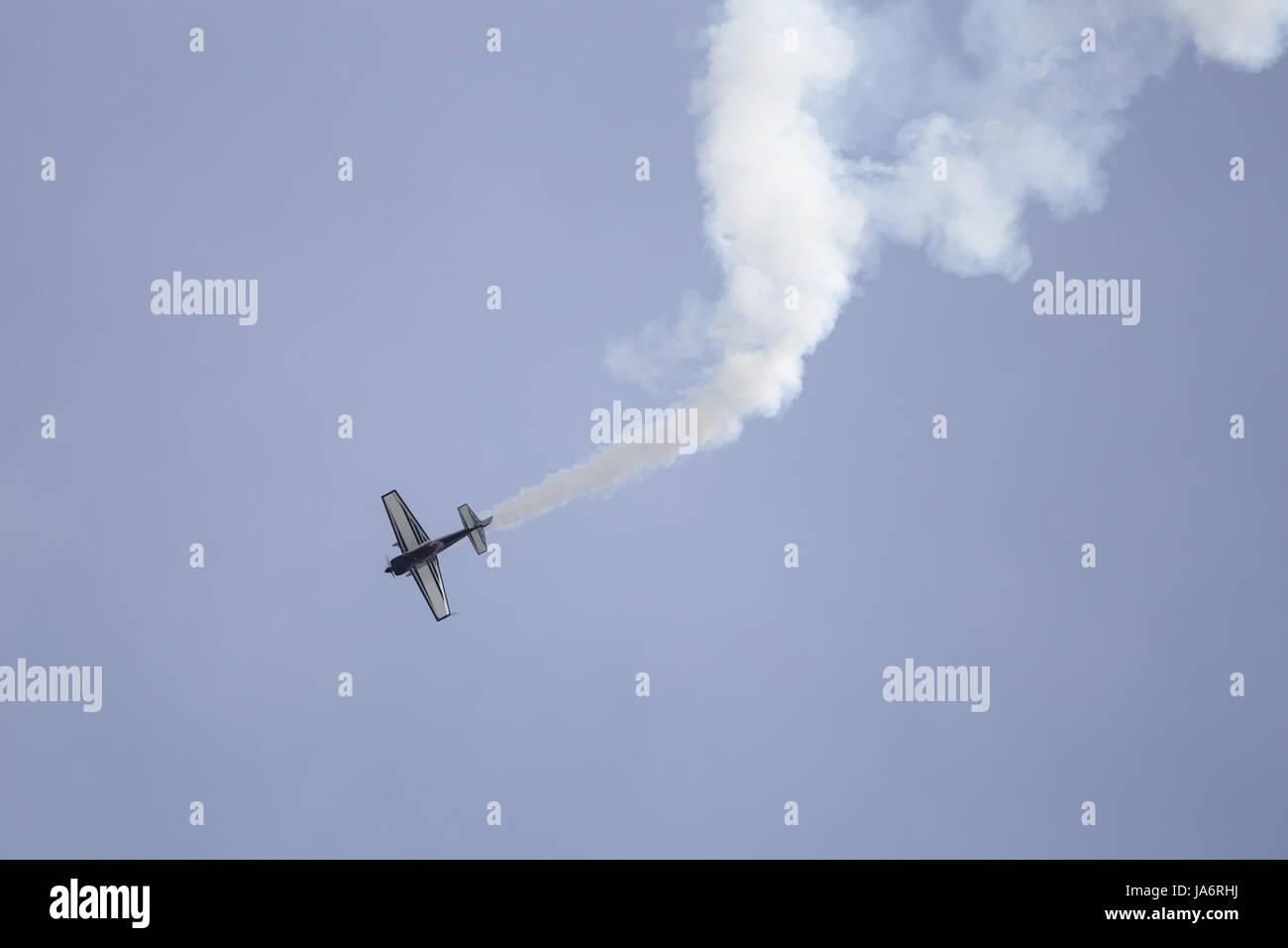 La Ferte Alais, France. 4th June, 2017. A plane performs acrobatics in the skies above the Aerodrome de Cerny, La - Stock Image