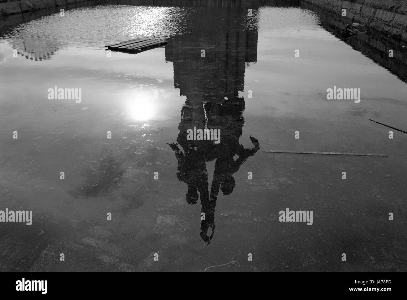 reflection in a pond - Worker and Kolkhoz Woman sculpture near All-Russia Exhibition Center in Moscow - Stock Image