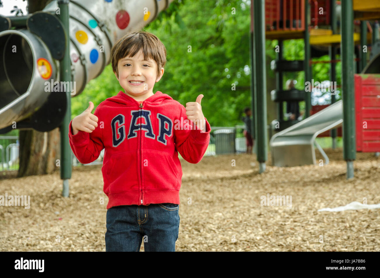 A young child playing in the children's playground in Prspect Park, Reading. - Stock Image