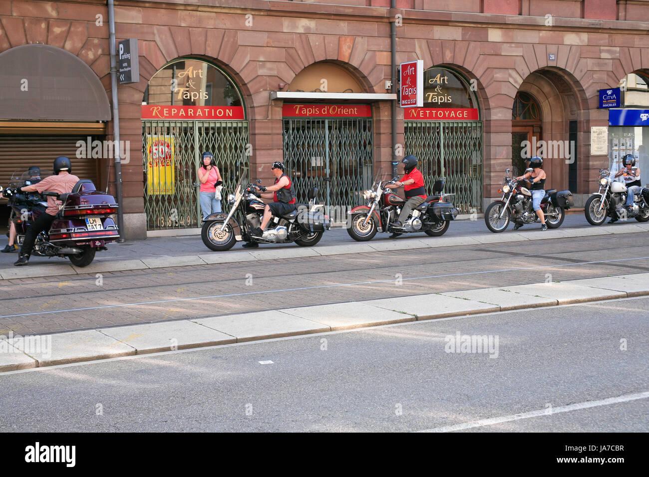 STRASBOURG,FRANCE - JULY 10: Aged bikers enter in garage in Strasbourg, France on July 10, 2010. According with - Stock Image