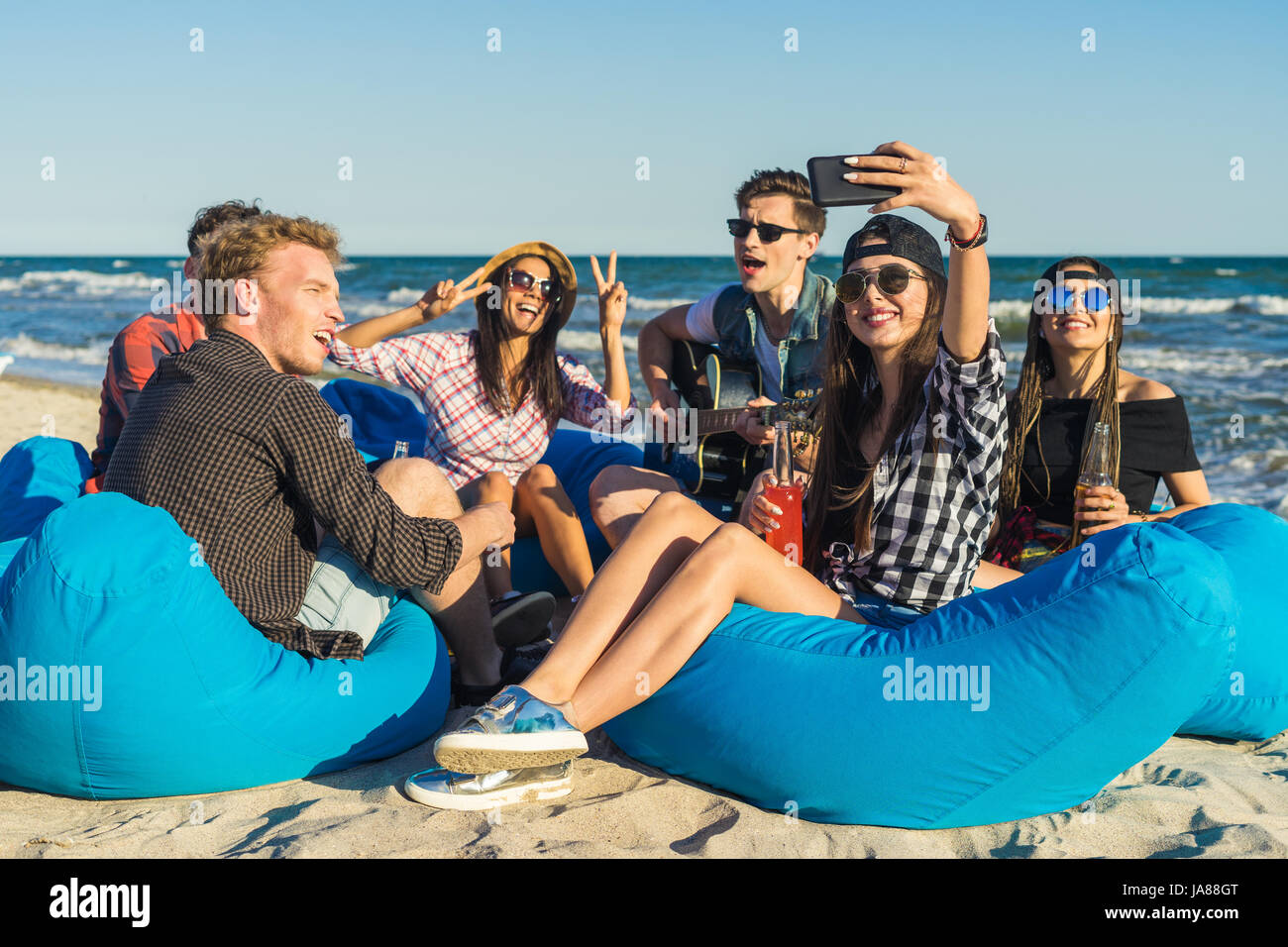 group of friends having fun at the beach - Stock Image