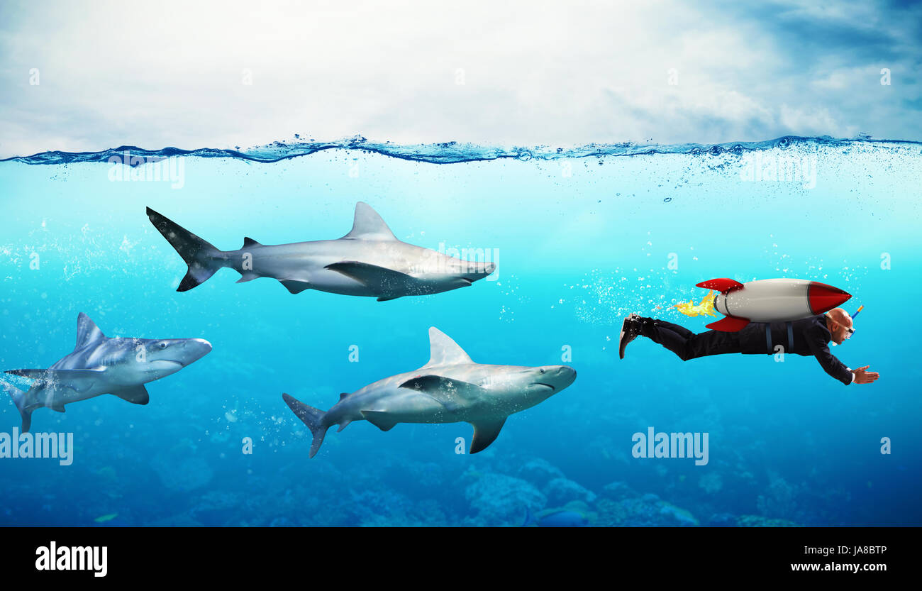 Concept of competition. Businessman escapes from sharks with a rocket - Stock Image