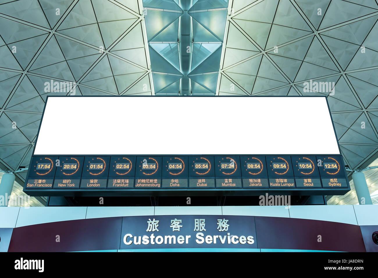 World Time and LCD TV at Hong Kong airport Stock Photo