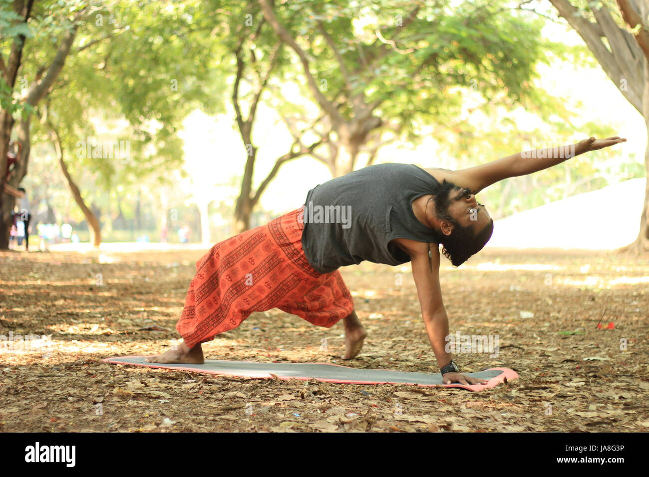 Young Indian performing yoga pose. Wild thing pose. chamatkarasan - Stock Image