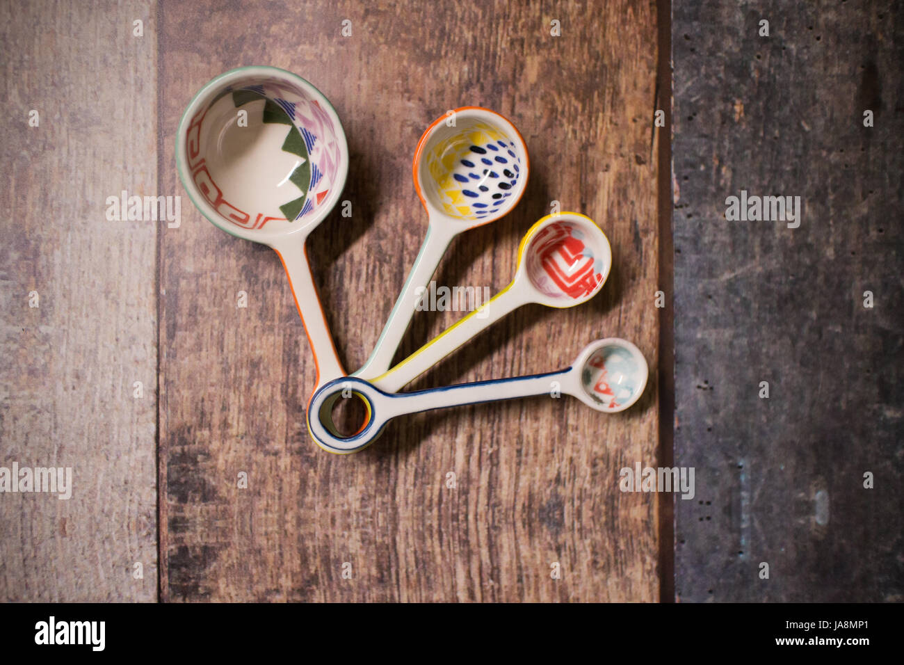 Colorful ceramic measuring spoons for cooking - Stock Image