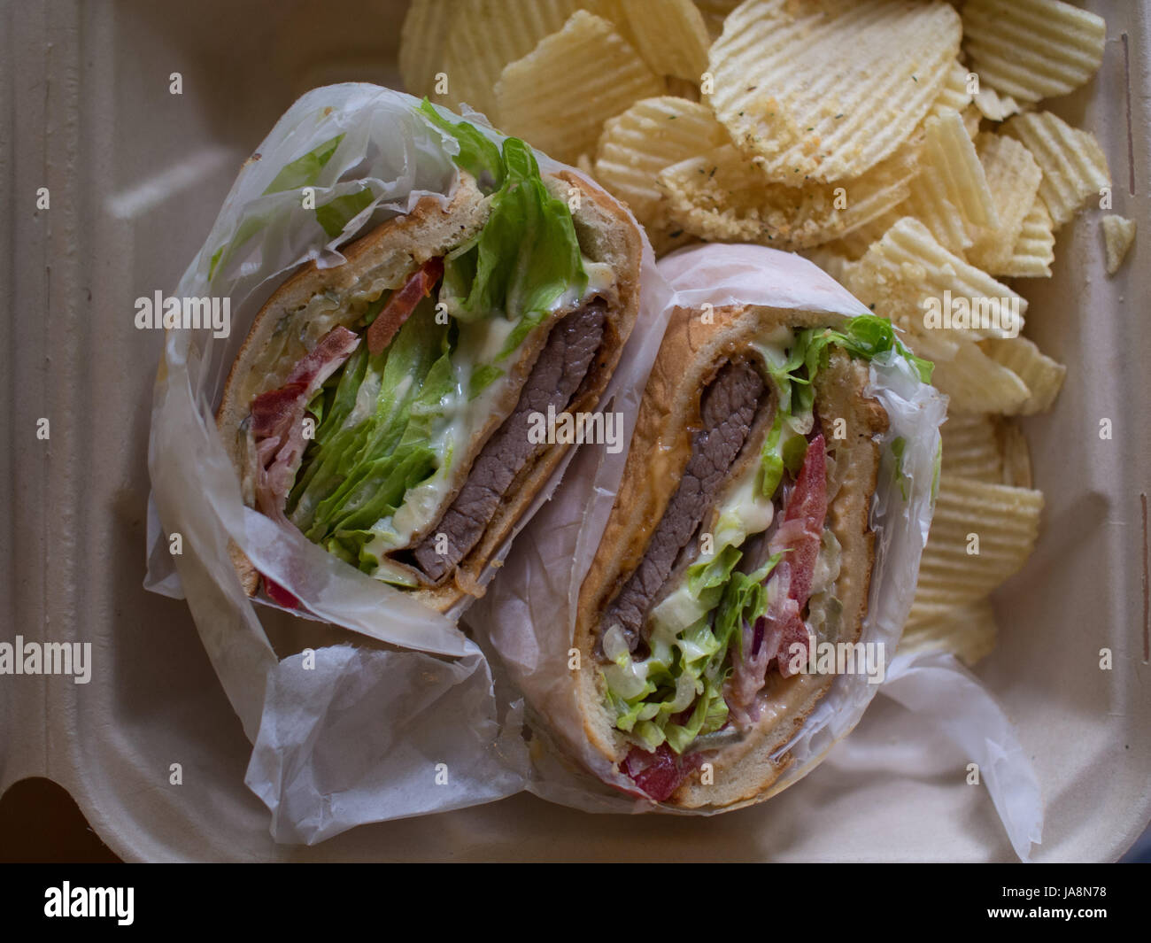 Steak sandwich with potato chips Stock Photo