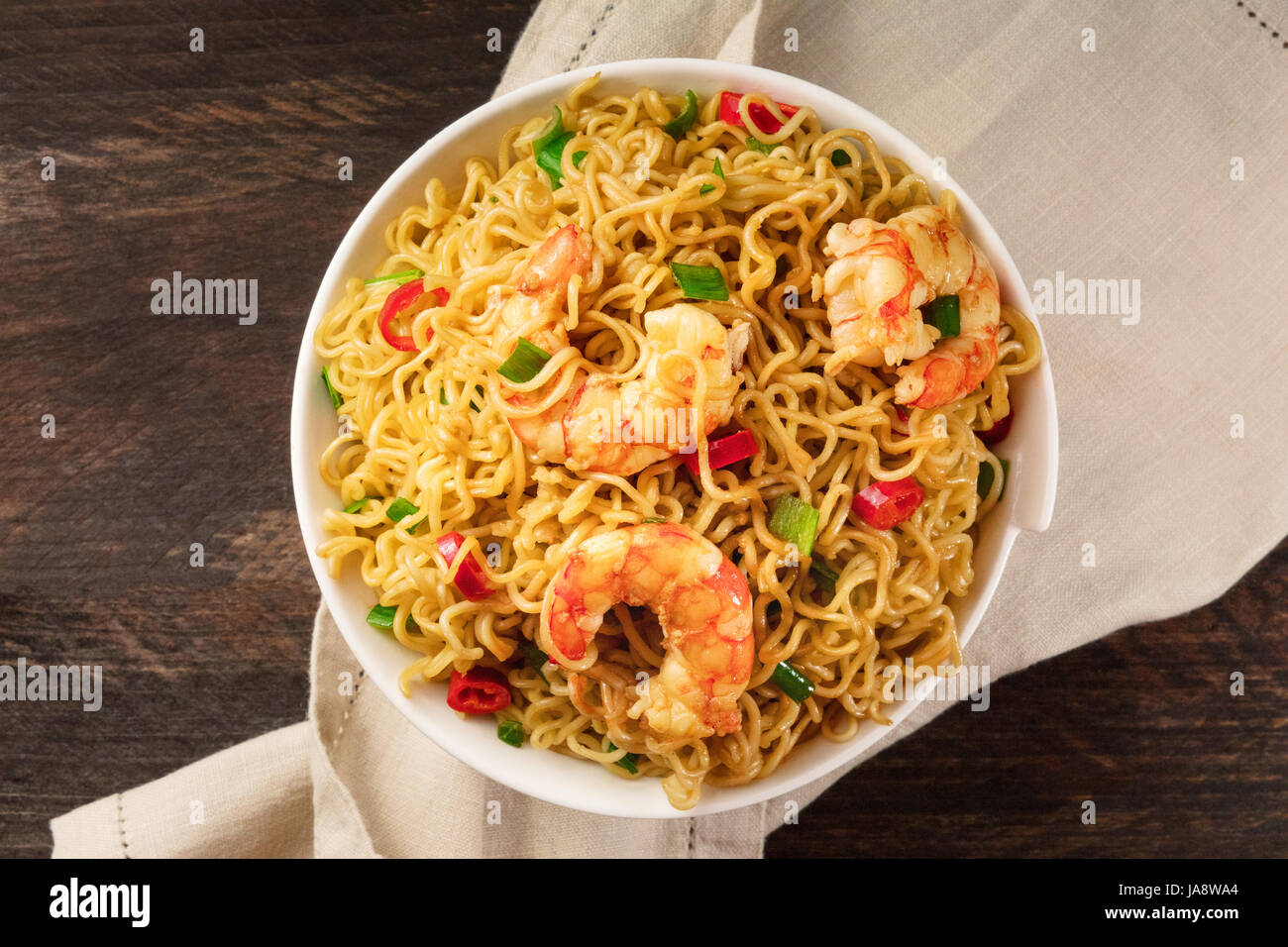 Instant noodles with vegetables, shrimps, and copy space - Stock Image
