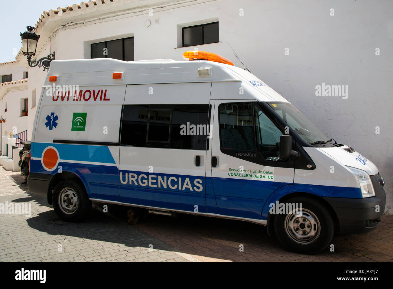 An ambulance parked on a street in Competa,  Andalusia, Spain, Costa del Sol. Stock Photo