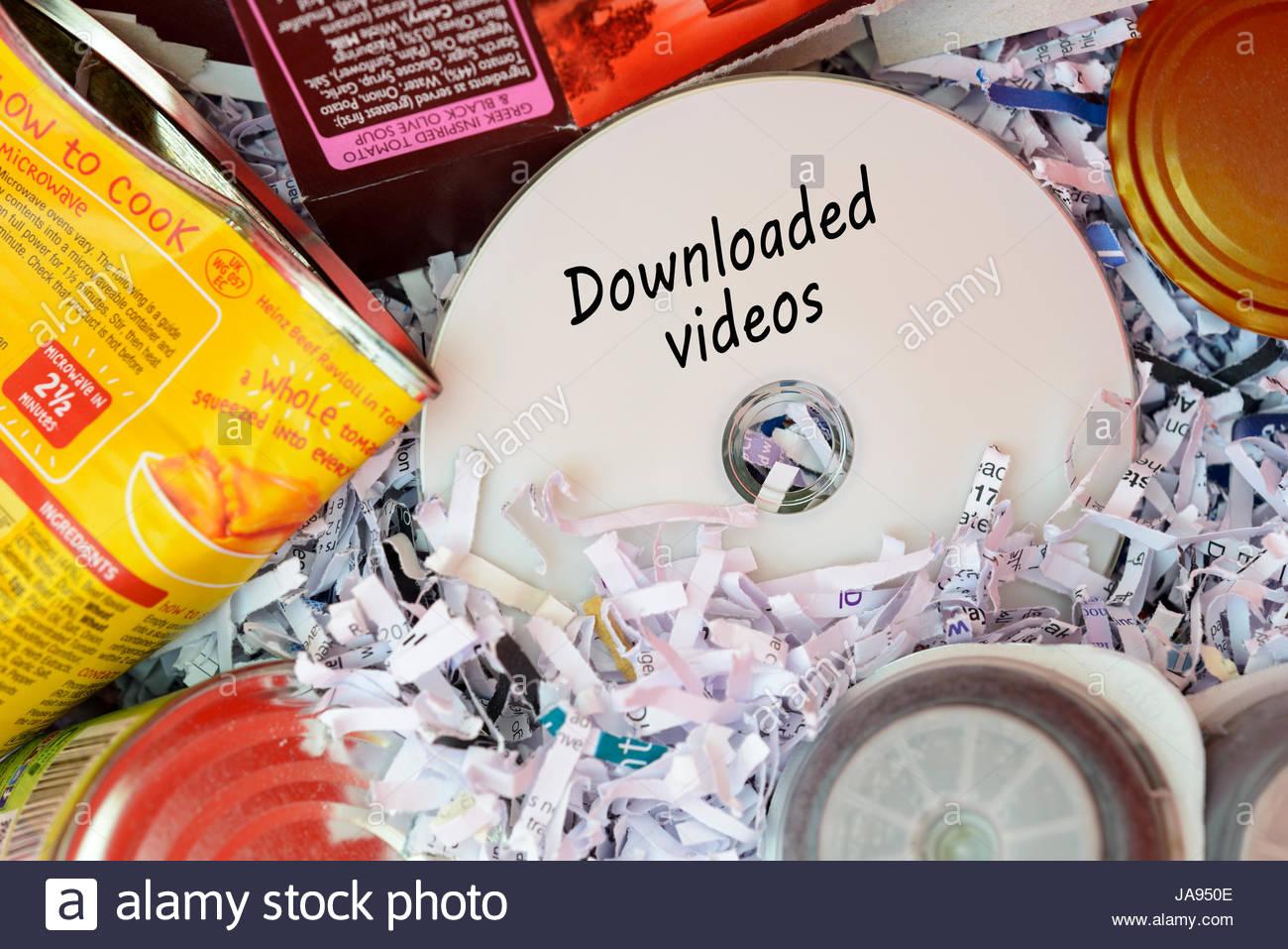 Downloaded videos, data disc thrown in Bin, Dorset, England. - Stock Image