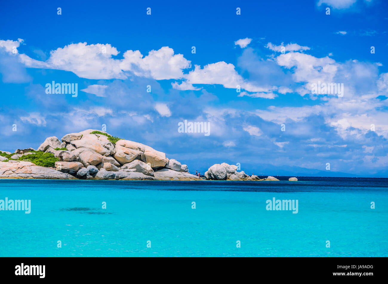 Bizarre granite rocks formation in amazing azure water on beautiful Sardinia island near Porto Pollo, Sargedna, - Stock Image