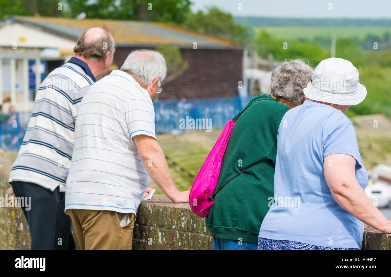 Nosy concept. Elderly people being nosy and looking at something. Nosey concept. - Stock Image