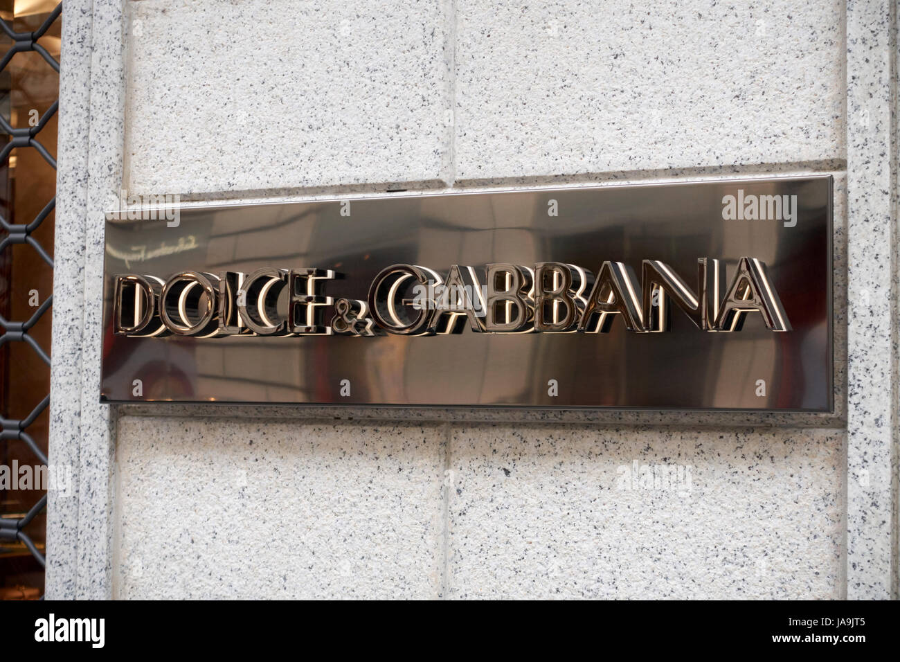 Dolce & Gabbana logo emblem on the facade of the store in Milnao, Italy - Stock Image
