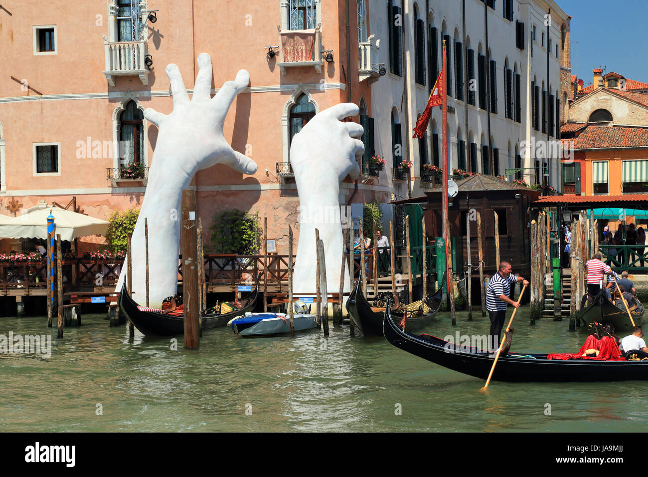 Giant hands sculpture in Venice by Lorenzo Quinn - Stock Image
