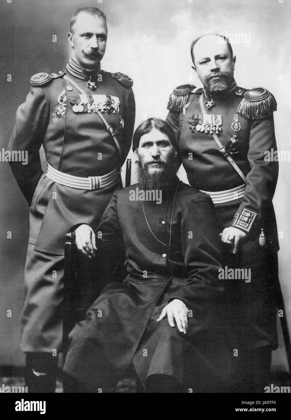 GRIGORY RASPUTIN (seated) with Prince Major-General Mikael Putyatin at left and Colonel Dimitry Lotman in 1904. - Stock Image