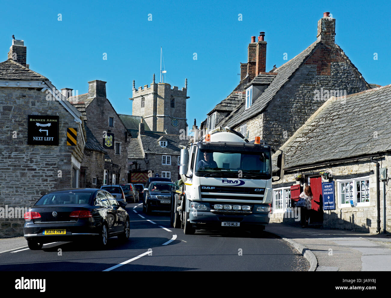 Traffic congestion in the village of Corfe Castle, Dorset, England UK - Stock Image