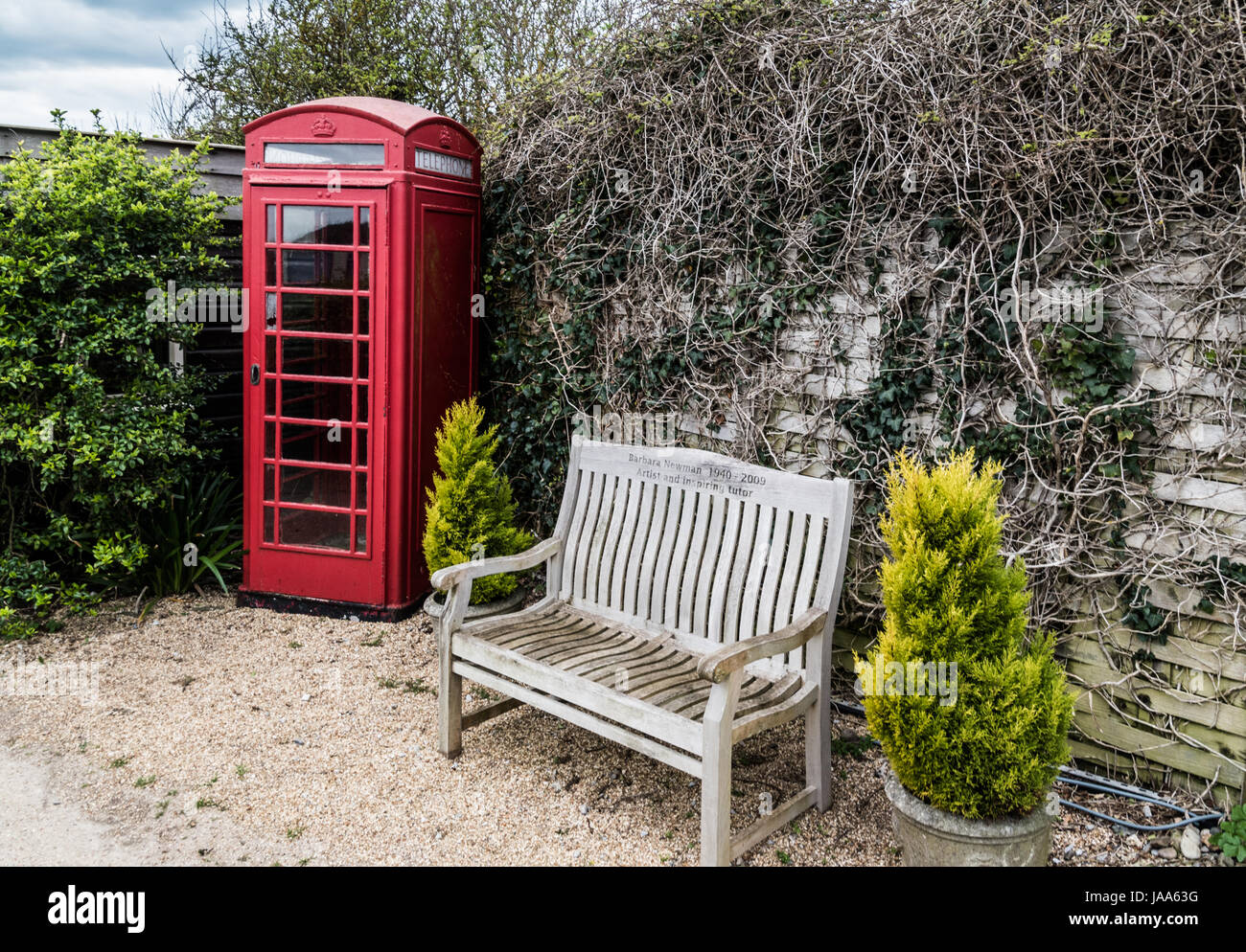 Red phone box and bench seat at Castlehaven - Stock Image