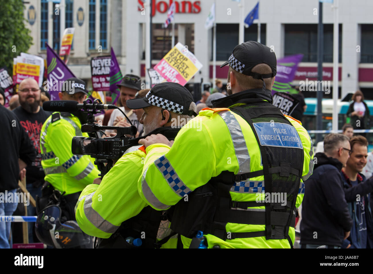 Policeman gathers video evidence during a rally by the far right group English Defence League and a protest by Anti - Stock Image