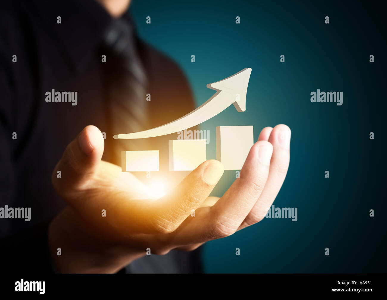 Hand holding a rising arrow, representing business growth - Stock Image