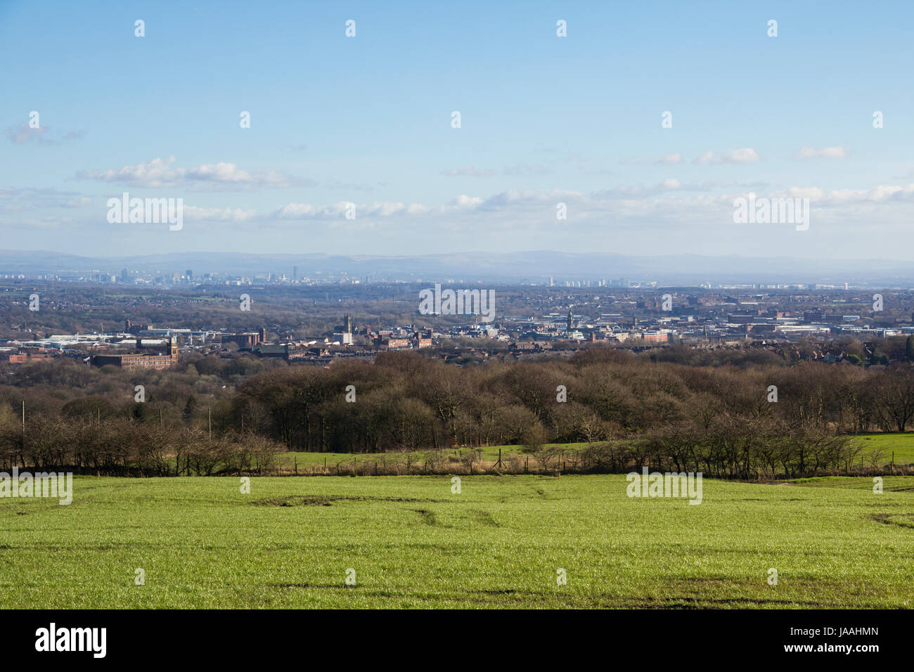 Landscape of Bolton taken from Scout Road, overlooking the width of the town centre. Beyond Bolton is Manchester - Stock Image