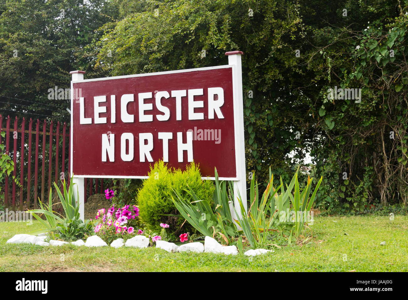 Leicester North railway station sign on the Great Central Railway preserved steam line which runs for 8 miles between - Stock Image