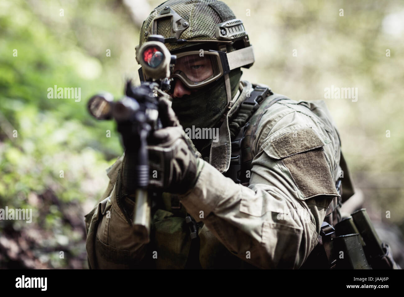Photo of sniper in woods - Stock Image