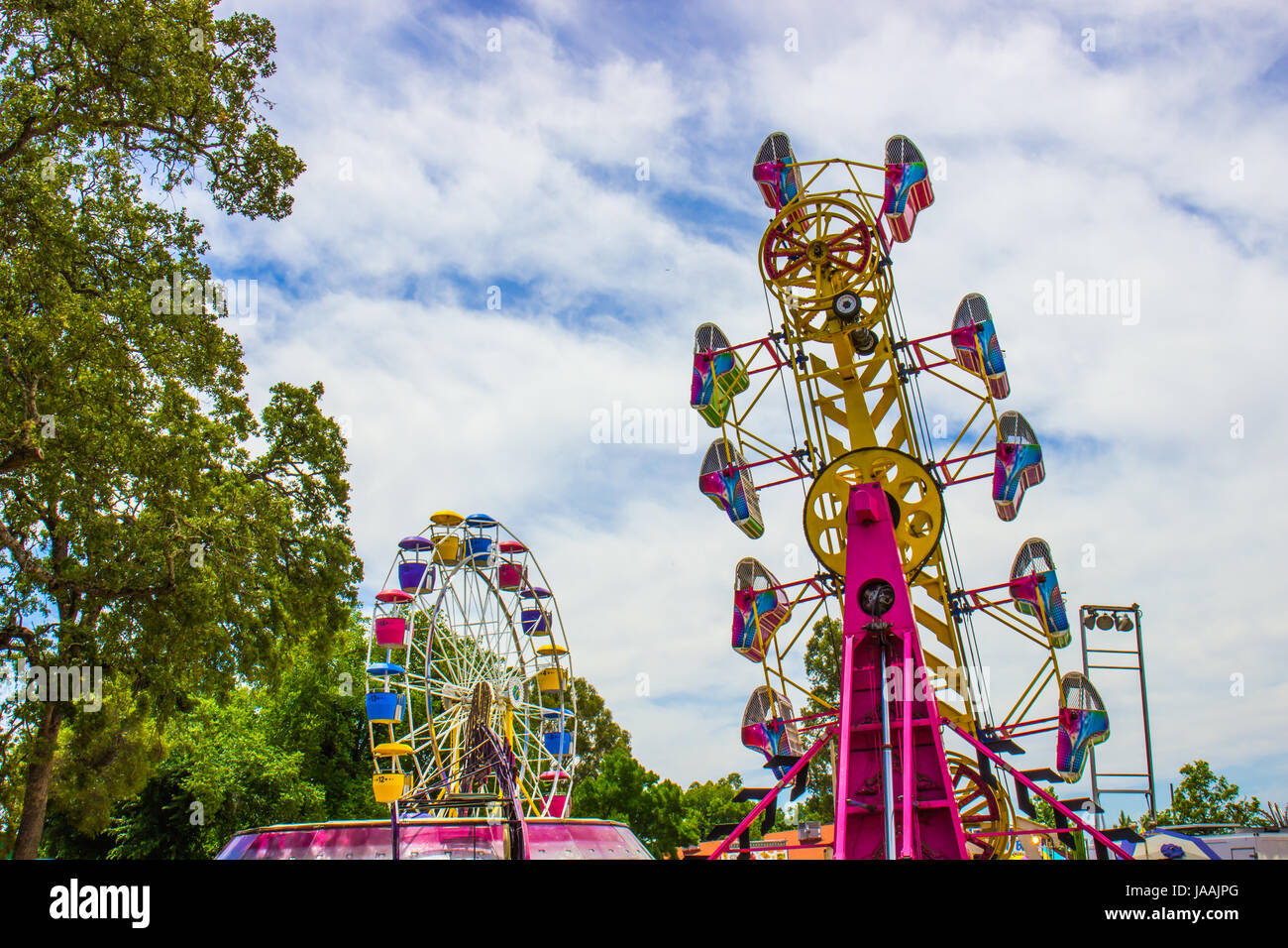 Two Amusement Rides At Local County Fair - Stock Image