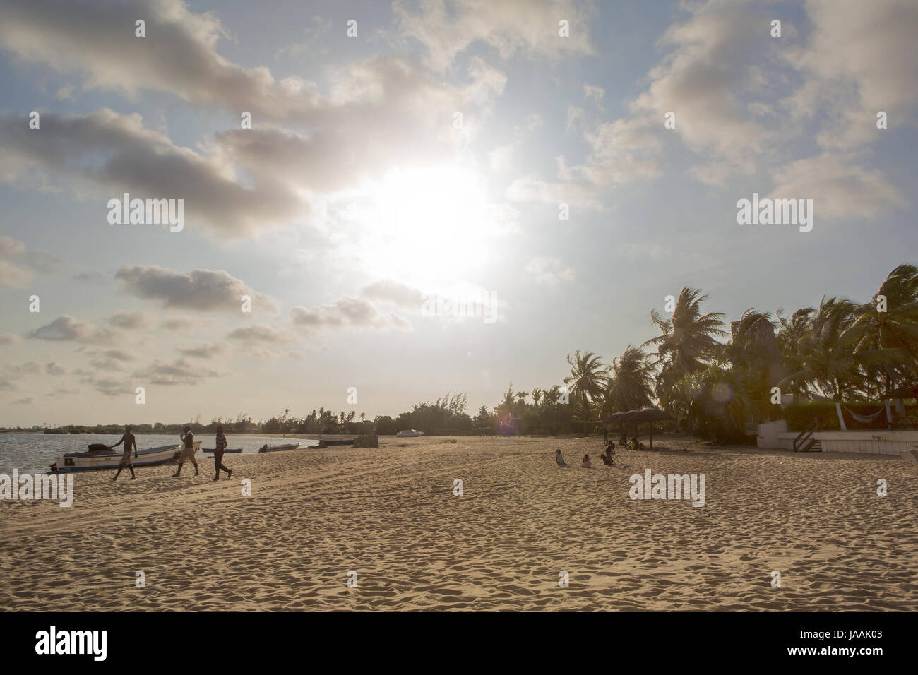 Sunset on the african tropical island of mussulo angola with boats, fishermen in silhouette - Stock Image