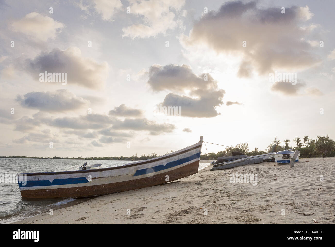Sunset on tropical island of angola mussulo with boats. - Stock Image