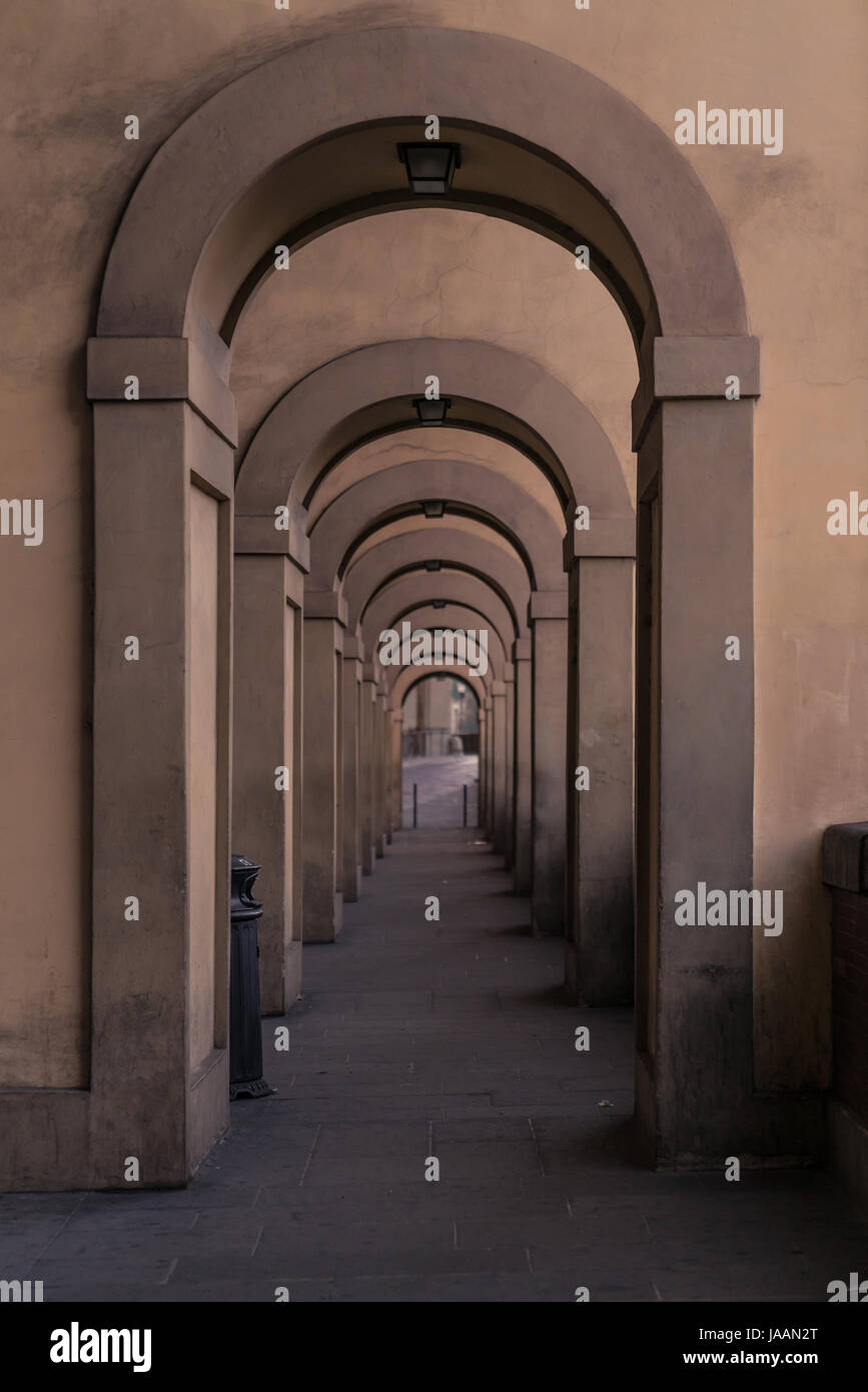 Series of arches along the Arno River in Florence with gradual fading focus. Stock Photo
