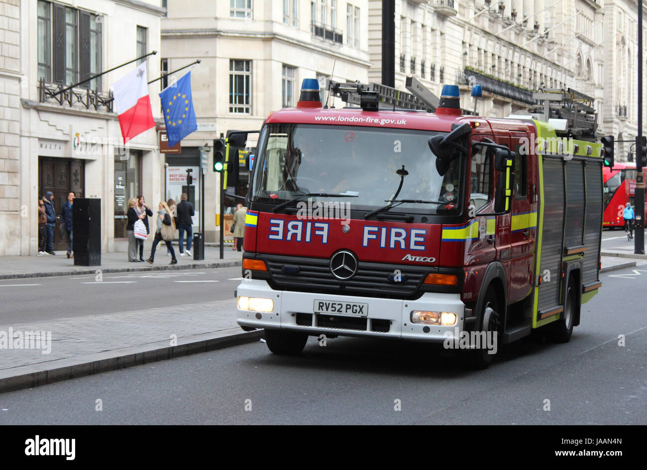 A London Fire Brigade emergency vehicle moving along Piccadilly, central London, UK, in November, 2014. - Stock Image